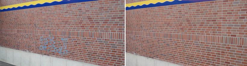 Graffiti Entfernung an einer Klinkerwand